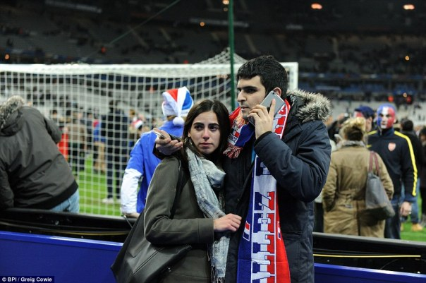 2E6CBCDB00000578-3317836-A_French_couple_stand_together_inside_the_Stade_de_France_after_-a-61_1447459227212