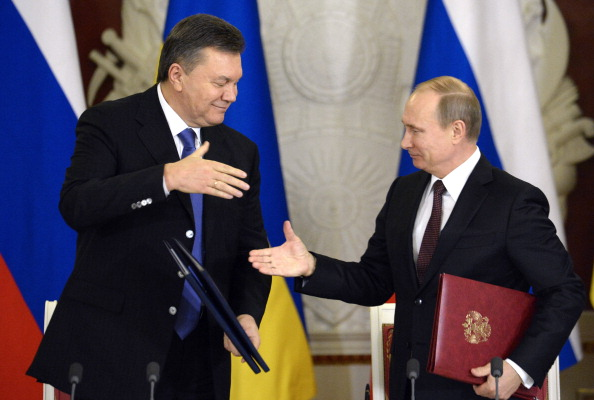 Russia's President Vladimir Putin (R) and Ukrainian President Viktor Yanukovych shake hands after signing documents during their meeting in the Kremlin in Moscow, on December 17, 2013. Putin said that the state energy companies of Russia and Ukraine had signed an amended agreement slashing the price Moscow charges its cash-strapped neighbour for natural gas. AFP PHOTO / ALEXANDER NEMENOV (Photo credit should read ALEXANDER NEMENOV/AFP/Getty Images)