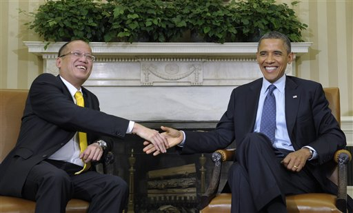 President Barack Obama meets with Philippines President Benigno Aquino, Friday, June 8, 2012, in the Oval Office of the White House in Washington. (AP Photo/Susan Walsh)