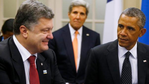 U.S. President Barack Obama is seated with Ukraine President Petro Poroshenko as they meet with other countries regarding Ukraine at the NATO summit at Celtic Manor in Newport, Wales, Thursday, Sept. 4, 2014. At rear center is U.S. Secretary of State John Kerry. (AP Photo/Charles Dharapak)
