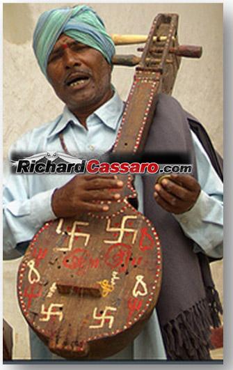 Indian-Hindu-with-swastika-guitar